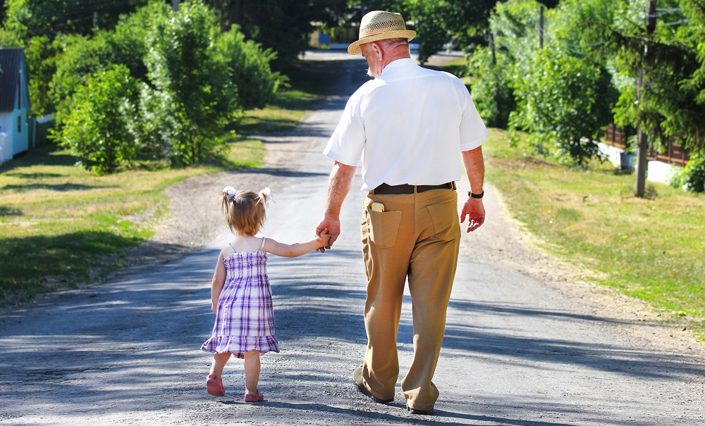 Grandfather walking with granddaughter Silver Magazine www.silvermagazine.co.uk