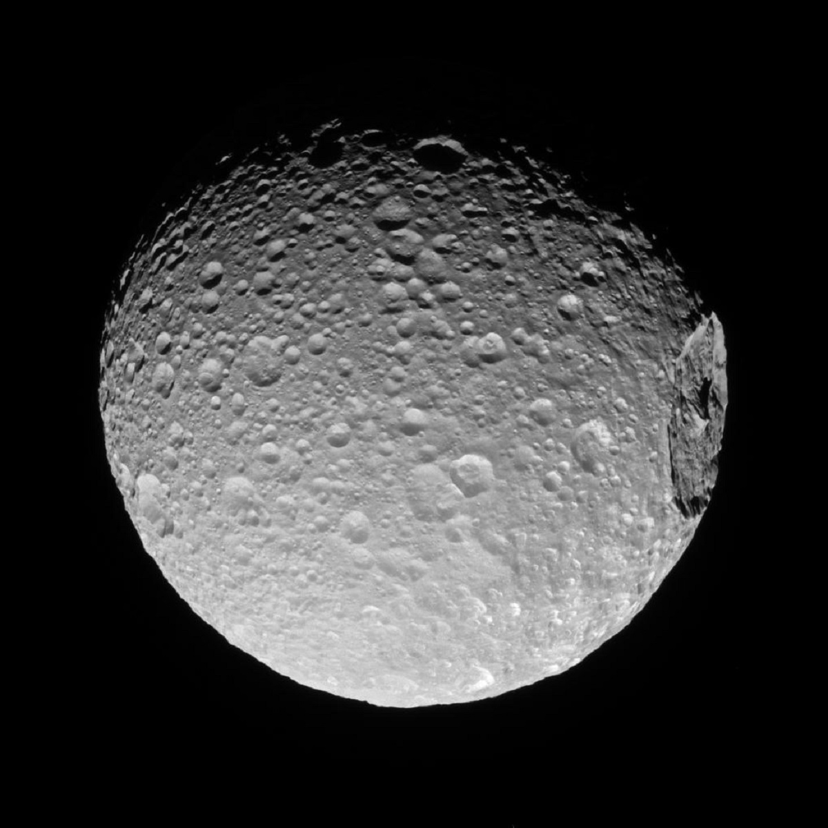 Crater on Mimas - NASA photos on Silver Magazine www.silvermagazine.co.uk